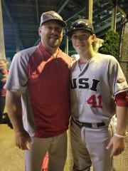 Logan Brown, now with the Rome Braves, poses with his father, Kevin, a former major leaguer. Both caught for USI.
