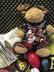 Mr. Moosey sports his badges and memorabilia from police