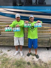 Wayne Thorp, left, and Wes Wyatt make up the Hold My Beer team, Boat 705, of the 2018 Texas Water Safari canoe race.