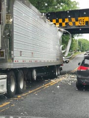 The top of a truck is peeled back after scraping the underside of the South Laurel Avenue railroad bridge in Holmdel.