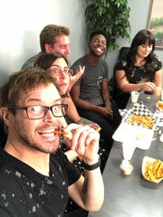 The Spectrum staffers enjoy french fries from local
