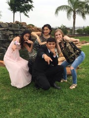 Jose Briones poses with his friends before attending a school dance at London High School.