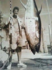 Bill Todt showing off a 585-pound tuna in 1961.
