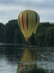 A hot air balloon crashes in Thompson Lake after hitting
