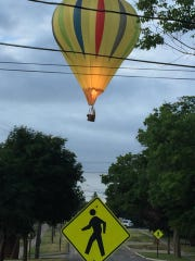 A hot air balloon crashes after hitting power lines