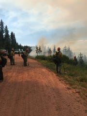 Hotshot teams are seen starting fire operations in