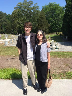 Longtime Georgia registered nurse Cathy Mitchell, now disabled, is shown with her grandson at his middle school graduation.