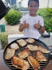 Wakulla 4-H have fun learning about grilling at camp.