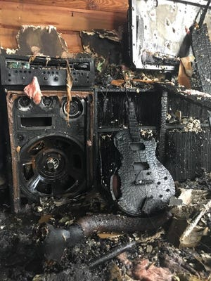 A guitar and amp are among the charred remains of a fire that destroyed the home of musician Chrysi Forton and her daughter, Lu.