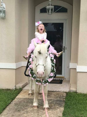 Tiny Tim makes a little girl's day as he surprises her at her birthday party dressed as a unicorn.