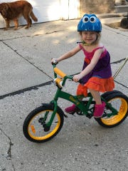 Little Addison Ray Thurmer has an easier time learning to balance on a two-wheeler with the dual rear wheel. Addie is a granddaughter of the brother of Eric Lenz, who is part of the two-man team originating and bringing the dually bicycle to market.