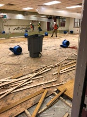 The Ankeny YMCA's first floor was flooded during flash flooding June 30 through July 1, 2018. Crews work to rip out damaged flooring.