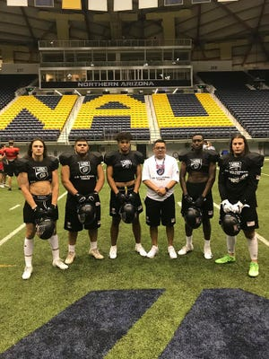 Defensive players  (left to right) Isaac Gilliam, ex-Glendale Cactus, Phoenix College, DB; Scott Jones, Cactus, Phoenix College, DL; Marquez White, Brophy Prep, S; Coach Michael Patterson; Andrew Onyepunuka, Brophy Prep, LB; Nathan Amico, Vail Cienega, University of Arizona, LB.