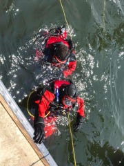 Members of the Perth Amboy Dive Team in the water.