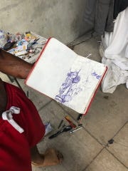 Bison, a homeless artist, drew this piece about the homeless camp under the overpass.