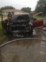 Collier County Sheriff's Office deputies were on scene when a vehicle caught fire after being struck by lightning in the Orangetree community in Golden Gate Estates shortly before 4 p.m. Monday, July 16, 2018. Nobody was injured.
