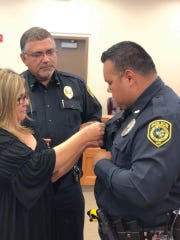 Robstown Mayor Mandy Barrera pins the Life Saving Award on police Officer Jimmie Zamora's uniform. Zamora saved a 3-month-old baby's life in June 2018.