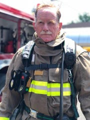 Wiley Gipson walks through training with his firefighter gear on.