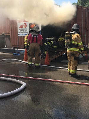 Firefighters train in the flashover trailer.