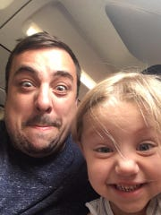 Father and son enjoy mugging for the camera. Shown