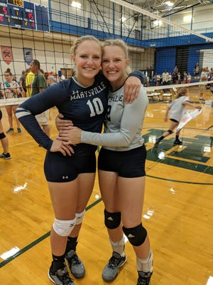 Marysville High School graduates Hannah and Hayley Delor pose for a photo at the MIVCA All-Star Game in Battle Creek.