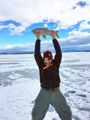 Drew Price holds up a whitefish while ice fishing on Keeler Bay in 2017. He entered this fish in the Master Angler Program, but used a different photo.