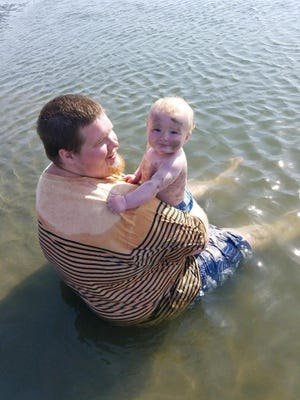 Emmett Harris, 24, with his son Sterling at Maggie Lake. Harris was killed in a head-on vehicle collision last week.