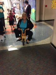 Michelle McCarley participates in an activity with
