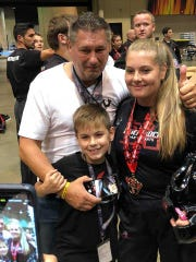The Malaszuk family did quite well at the Tiger-Rock International taekwondo championships in Birmingham, Alabama, last month. Peter, 50, won a gold and a silver. Olivia, 16, won three golds and a bronze. Oliver, 9, won a silver and a bronze.