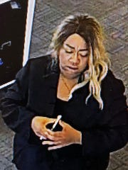 Knoxville police are working to identify this woman in connection with a robbery at the AT&T store, 5400 Clinton Highway, on Sunday, Aug. 5, 2018.
