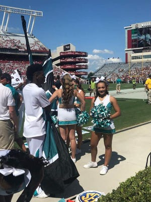 Makayla Hackett, a Lee High graduate, cheered at her first Coastal Carolina football game Saturday when the team traveled to the University of South Carolina.
