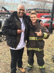 "Derrick Gilliam, left, on the set of ""Chicago Fire."""