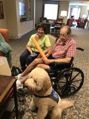 """My needs for a trainer were similar to others - I needed to be trained as well as my 70-pound Labradoodle Rascal. I wanted him to become a Therapy Dog so that I could take him to work with me at a local Alzheimer's facility. He needed to be trained to not pull on a leash, not run when called. He had to know what rooms in the facility he was allowed to go into and what rooms were off limits. How to react to different odors, noises, wheelchairs and walkers. How to walk properly off leash around different residents and equipment. A huge task for anyone to take on - but Carrie more than rose to the occasion. She worked hours with me alone and with me and Rascal. I learned to be the Alpha Dog - hahaha. My husband and I are so thrilled with Rascal. He is a huge hit at work and loves to snuggle with the residents. Thank you from all of us, Carrie. We love you and are so thankful we found you!"" - Marty and Pam McMahon"