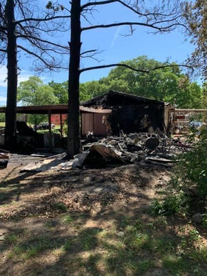 Three local volunteer fire departments worked together Friday morning to put out a large structure fire at a residence located off of Newport Road in Lake Murray Village.