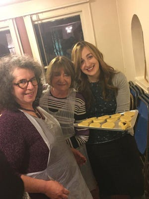 """Rivkie Borenstein, Adrienne Butvinik ob""""m and Leslie Roosa making Mamentash at a previous Hamentash Bake for women at the Chabad Center in Goshen. This year's Hamentash Bake will take place on March 3."""