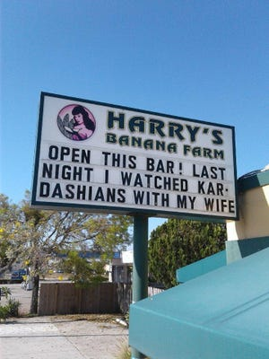 Harry's Banana Farm, a popular bar in Lake Worth Beach,  is known for its signs, such as this one displayed in late March. It and other bars throughout the county will be allowed to reopen immediately, Gov. Ron DeSantis decided Friday.