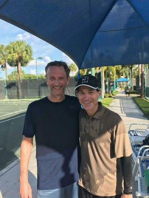 "Writer Steve Dorfman (right) with one of his many ""tennis friends,"" John Serraino of Boca Raton, at the Swim & Racquet Center, which has been closed since mid-March."
