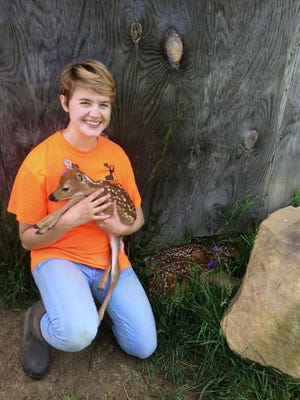 Molly Anne Chlovechok holds a fawn during her time as a student at Hocking College. After graduating she transferred to West Virginia University.