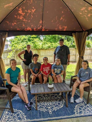 Swansboro High School Interact Club members Abigail, Reagan, Mandolyn, Danielle and Alexa recently donated and constructed a new gazebo at the Onslow Women's Center safe house. The club did several fundraising projects for the gazebo and furniture.