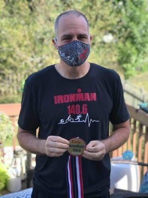 Steven Mauro, Gannon University's vice president for academic administration, completed an Ironman-distance triathlon in Erie on Saturday.