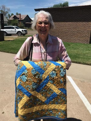 Diane Baublits was thrilled to win the quilt drawing.