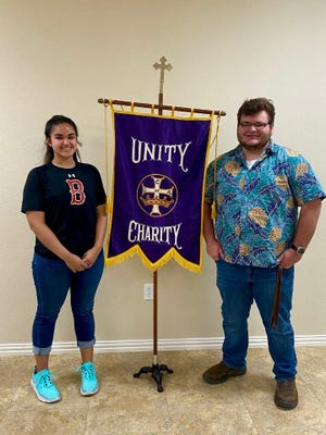 Our Lady of Grace #1734, Catholic Daughters of the Americas, Rowena, presented a $200 Graduate's Award to Julia Martinez and Chris Irby,