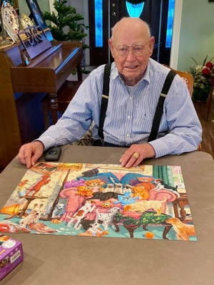 Douglas Mayo working on a puzzle.