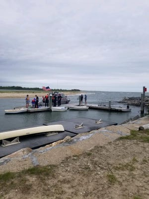 Two teens were rescued in Falmouth after being stranded on their boat Thursday. Falmouth Fire Department photo