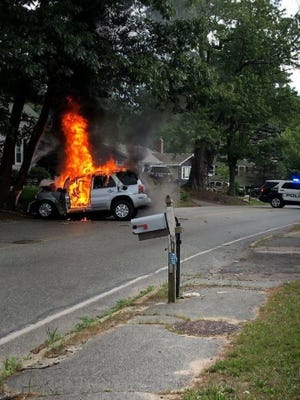 A sport-utility vehicle burns on Hingham Street in Rockland following a crash into a tree, June 21, 2020. Photo by Rockland Fire Department.