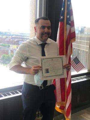 Easton firefighter/paramedic Antonio Ioannidis of Taunton became a US citizen on June 12.