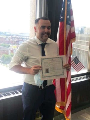 Easton firefighter/paramedic Antonio Ioannidis of Taunton became a US citizen on June 12.