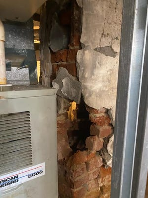 The bottom part of a chimney stack crumbled inside a New Bedford home after an earthquake struck nearby on Nov. 8, 2020.