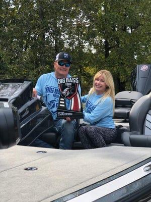 Brad and Rhonda Smith pose with Big Bass Tournament winners' trophy, Nitro bass boat.