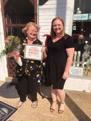 Pekin Marigold Festival Committee chairperson Baylee Gambetti (right), presents a certificate and flowers to 2020 Grand Marshal Mary Haynes.
